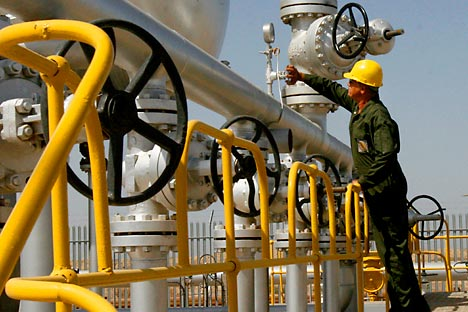 Iranian oil technician Majid Afshari checks the oil separator facilities in Azadegan oil field, near Ahvaz, Iran. Source: AP