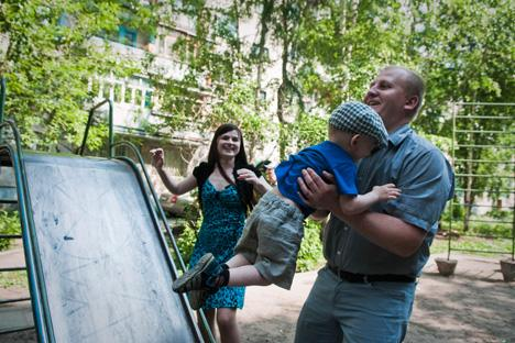 The Frolov family has fun in the yard near their apartment building. Source: Oksana Yushko