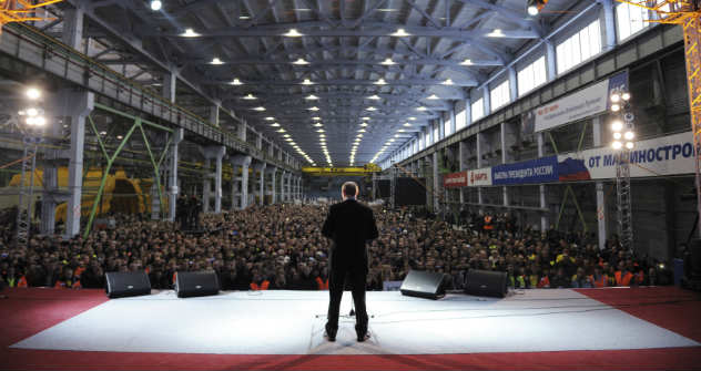 Russia's Prime Minister Vladimir Putin addressing the audience during a meeting of All Russia People's Front, an umbrella movement of his supporters, in the city of Kemerovo. Source: Reuters/Vostock-Photo