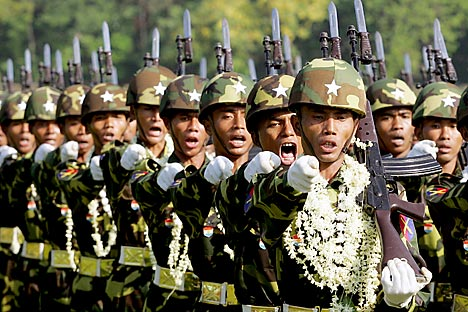 Myanmar troops march in Resistance Park to celebrate 60th anniversary of the Myanmar Armed Forces Day in Yangon. Myanmar troops march in Resistance Park to celebrate the 60th anniversary of the Myanmar Armed Forces Day in Yangon. Reuters/Vostok-Photo