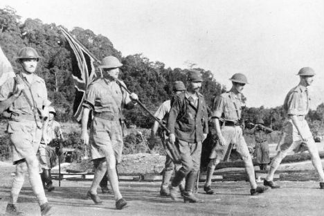 Lt Gen. Arthur Percival, led by a Japanese officer, walks under a flag of truce to negotiate the capitulation of Allied forces in Singapore, on 15 February 1942. It was the largest surrender of British-led forces in history.