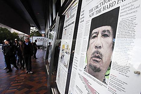 Imagen de Muamar Gadafi en los titulares del día 21 de octubre. Fuente: Reuters / Vostock Photo