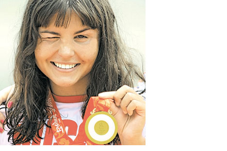 Eight-time world champion Larisa Ilchenko took gold in the inaugural 10km open water swimming marathon