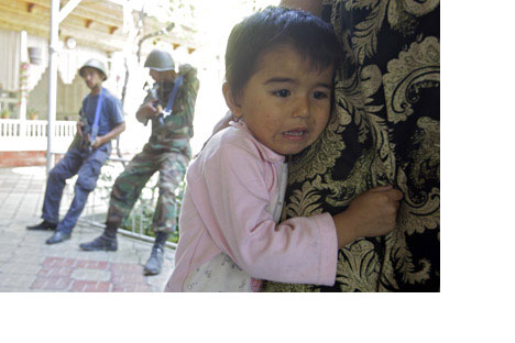 An Uzbek girl after Kyrgyz policemen conducted house-to-house searches in Kyrgyzstan