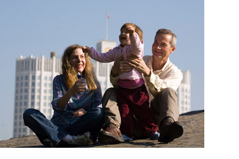 American adoptive parents play with their Russian-borndaughter in Moscow