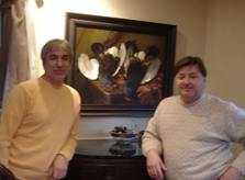 Artist Ivan Kugach at his painting  with his friend artist Oleg Nefedkin