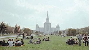 Students relaxing on the lawn in front of Moscow State University