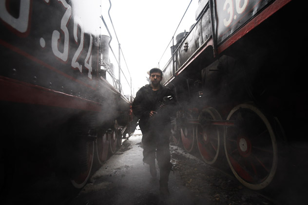 A railway worker examining wagons at St. Petersburg's Russian Railways (RZD) depot, responsible for  the repair and technical services of steam engines. Source: RIA Novosti/Vadim Zhernov