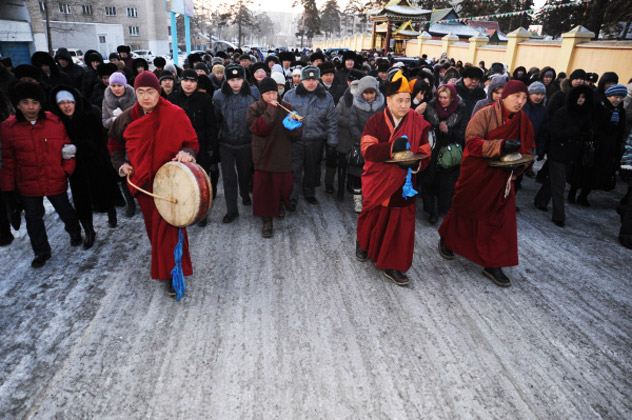 """Feb. 20, 2012 - Buddhist monks officiating the """"Dugzhuuba"""" (ritual purification) ceremony to mark the arrival of the New Year according to the lunar calendar. The ceremony took place in Chita's Datsan, the Buddhist temple of the Siberian city. Source: RIA Novosti / Denis Gukov"""