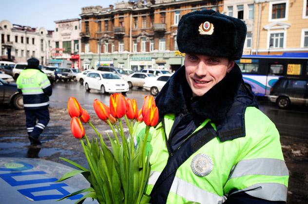 A Russian traffic policeman at work during International Women's Day. Source: ITAR-TASS