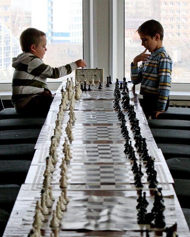 Chess players taking part in the under 10 chess championship in Vladivostok.  Source: RIA Novosti / Vitaliy Ankov