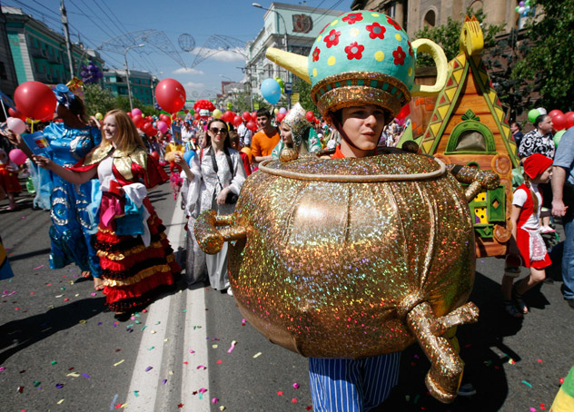 People walk during the City Children's Carnival in the centre of Russia's Siberian city of Krasnoyarsk June 1, 2012. More than 3,000 children, their relatives and teachers took part in the procession to celebrate International Children's Day, according to organizers. Source: Reuters
