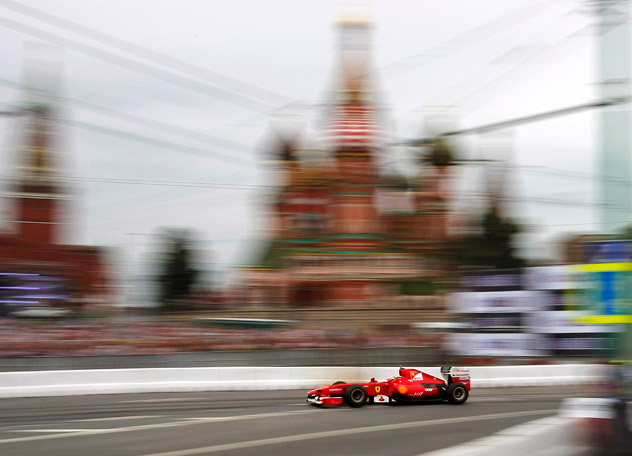 Ferrari F1 driver Giancarlo Fisichella of Italy drives during the Moscow City Racing 2012, with Saint Basil's Cathedral in background, along the Kremlin, in Moscow, Russia, Sunday, July 15, 2012. The third Moscow City Racing show featuring Formula 1 race cars piloted by the leading teams, McLaren, Mercedes and F1 Ream Marusia took place Sunday in the very heart of the Russian capital. Source: AP