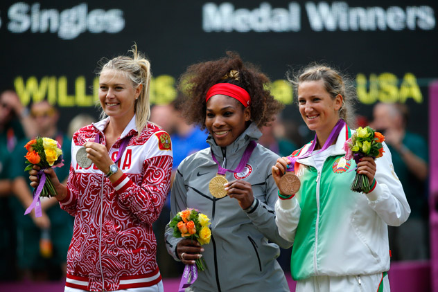 Serena Williams of the U.S. poses with the silver medal winner, Russia's Sharapova, and bronze medallist Azarenka of Belarus at the All England Lawn Tennis Club during the London 2012 Olympic Games. Source: Reuters / Mike Blake