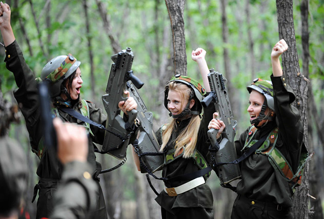 Russian teenagers participate in a simulated military exercise during a Sino-Russia youth summer camp in Sunwu County, northeast China's Heilongjiang Province, Aug. 14, 2012. Some 80 teenagers from China and Russia took part in a five-day summer camp under the theme of peaceful development here. During the camp, the teenagers participated in a simulated military exercise. Source: AFP / East News