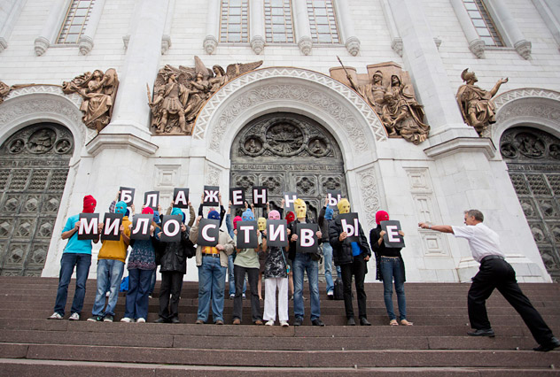 """Supporters of female punk group Pussy Riot hold signs to form a message during a protest on the steps of the Cathedral of Christ the Saviour in Moscow August 15, 2012. Security guards scuffled with masked protesters who demonstrated outside Moscow's main cathedral on Wednesday in support of three members of the Pussy Riot punk band who are on trial for staging an irreverent protest at the same church. The message reads, """"Blessed are the merciful"""". Source: Reuters / Vostock-Photo"""