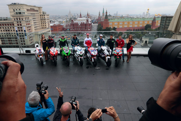 Superbike World Championship riders, from left, Max Biaggi, of Aprilia Racing Team, Tom Sykes, of Kawasaki Racing Team, John Hopkins, of FIXI Crescent Suzuki, Carlos Checa, of Althea Racing Ducati, Leon Halsam, of BMW Motorrad Motorsport and Jonathan Rea, of Honda World Superbike Team, pose during a photo call atop a hotel roof in downtown Moscow, Russia, on Thursday, Aug. 23, 2012. Russia's first ever Superbike Championship event will take place this coming weekend.