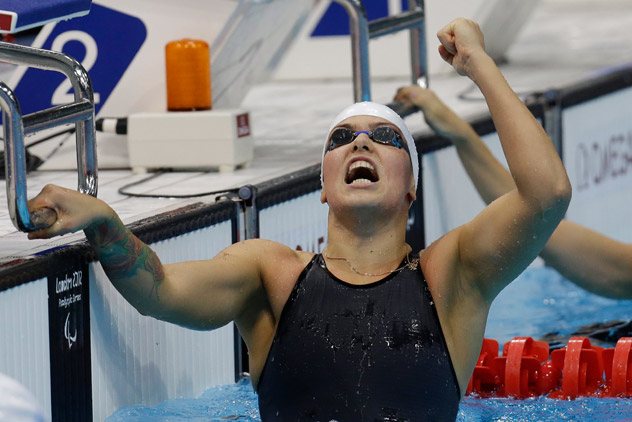 Russia's Oxana Savchenko celebrates after winning the 5th gold medal in the women's swimming at the 2012 Paralympics. Source: AP / Lefteris Pitarakis