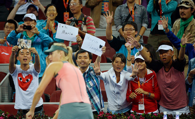Fans wave to world number two Maria Sharapova of Russia with fans during her women's singles match against Simona Halep of Romania at the China Open tennis tournament in the National Tennis Center of Beijing on October 1, 2012. Sharapova went on to win 7-5, 7-5. Source: AFP/East News