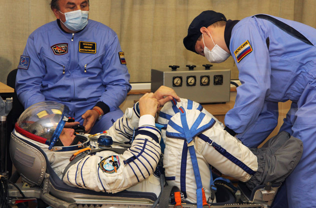 Wearing a space suit a crew member of the next expedition to the International Space Station (ISS), Russian cosmonauts Oleg Novitskiy, takes part in the preflight preparation at the Russian leased Kazakhstan's Baikonur cosmodrome on October 10, 2010. The launch of the crew, including Novitskiy, US astronaut Kevin Ford and Russian cosmonaut Evgeny Tarelkin, to the International Space Station is scheduled for Oct. 23. Source: AFP / EastNews