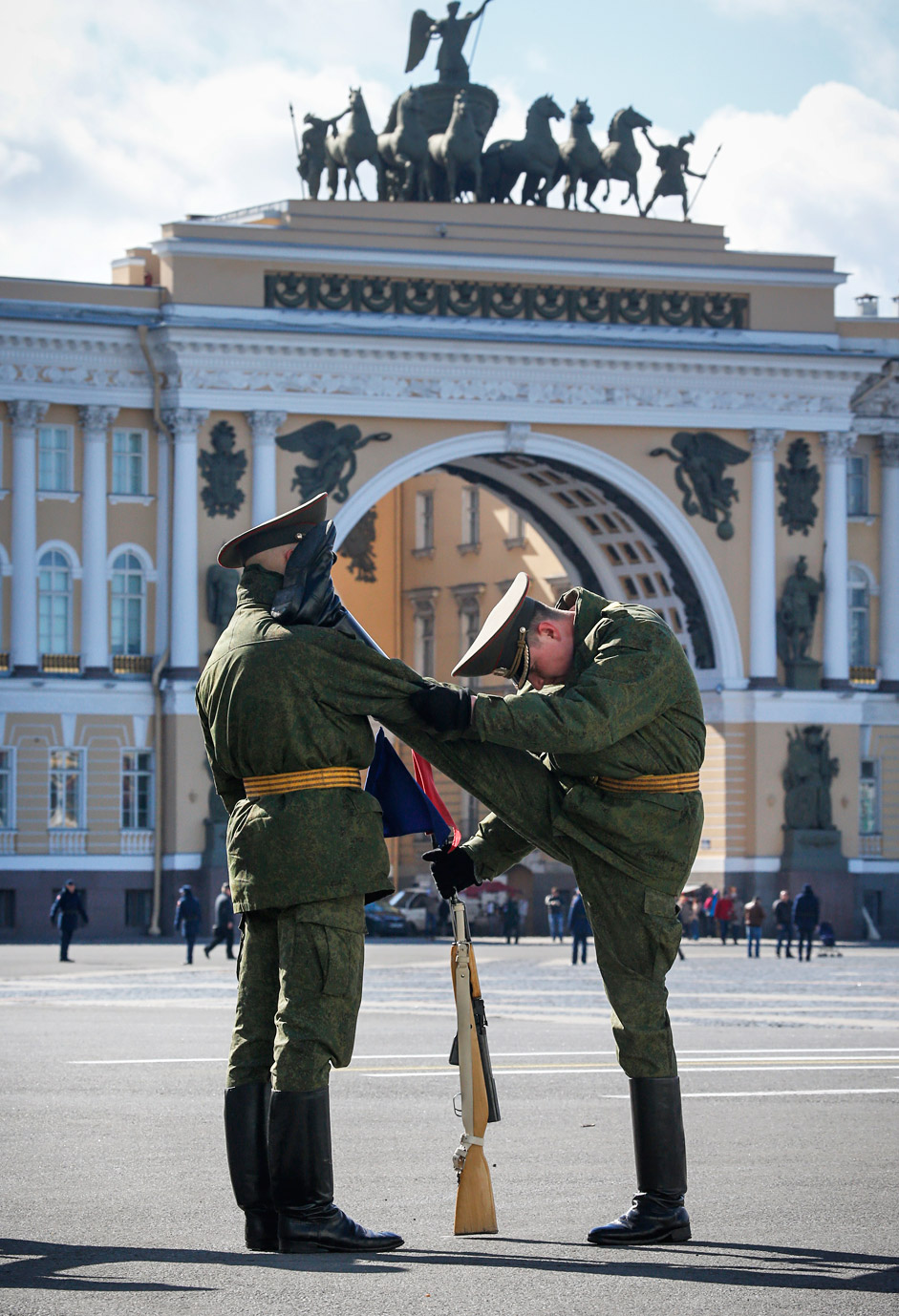 Soldiers warm up prior to a rehearsal for the Victory Day military parade
