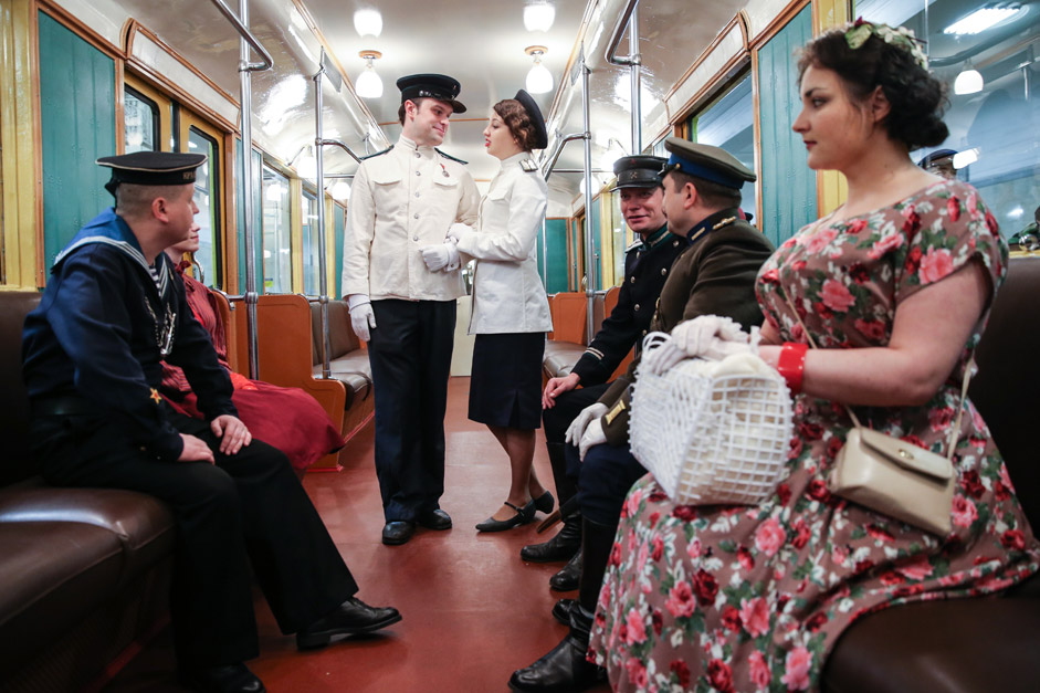 People wearing period costumes in a retro train at Partizanskaya Station as part of celebrations marking 80th anniversary of the Moscow Underground. Sergei Savostyanov/TASS