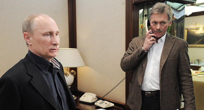 Dmitry Peskov (R) was appointed as Vladimir Putin's press secretary in 2000. Source: RIA Novosti