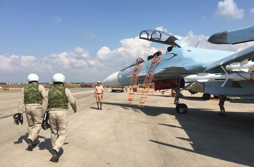 The crew of a Russian Su-30 fighter prepare to take off at Hmeimim aerodrome in Syria.