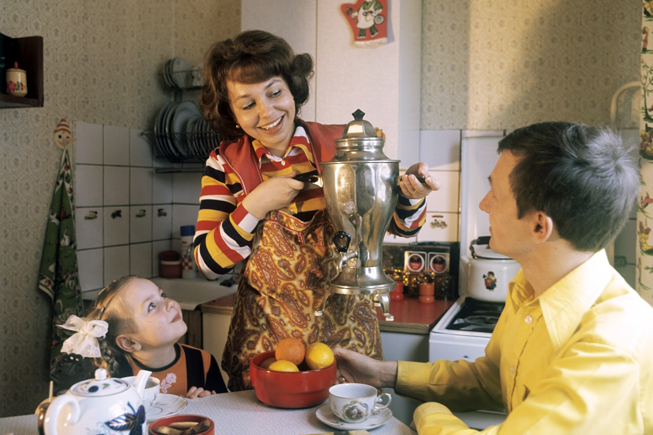 Soviet kitchen gadgets. (Vladimir Drozdov, service engineer at the 1st Moscow cotton-printing mill, at home with his wife Marina and daughter Anya.)