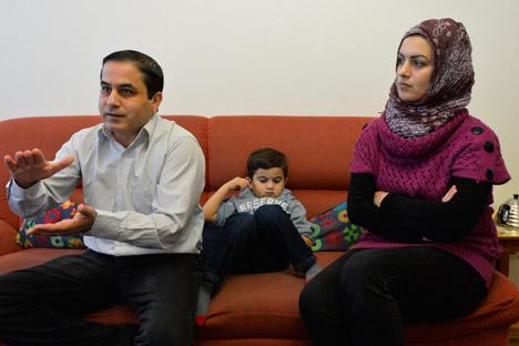 Jarob Rashid (links) mit seiner Familie. Foto: Michail Sinizyn