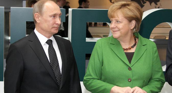 Der russische Präsident Wladimir Putin und die Bundeskanzlerin Angela Merkel während der Hannover Messe im April 2013. Foto: DPA