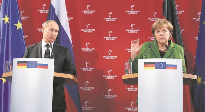 Der Dialog soll wieder besser werden. Wladimir Putin und Angela Merkel auf der Hannover Messe 2013. Foto: Reuters