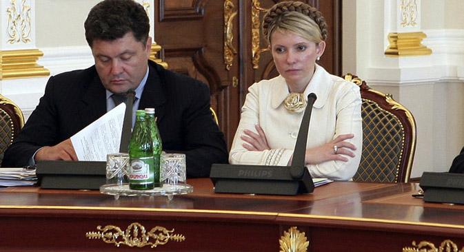 Zwei Spitzenkandidaten bei den Präsidentenwahlen in der Ukraine: der Schokoladen-König Pjotr Poroschenko (links) und ehemalige Premierministerin der Ukraine Julia Timoschenko (rechts). Foto: AP