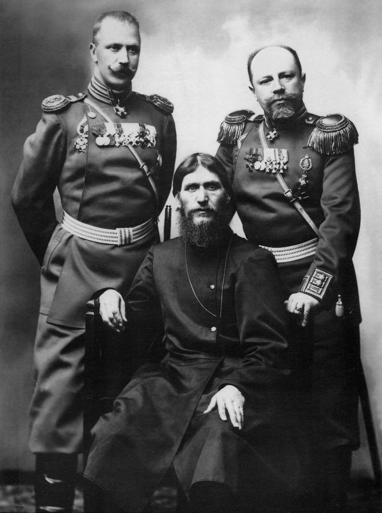 He was also the official photographer of many state organizations, including the Interior Ministry, the Navy and Army Ministries, and the State Duma. // L-R: Colonel Loman, Grigory Rasputin, General Putyatin