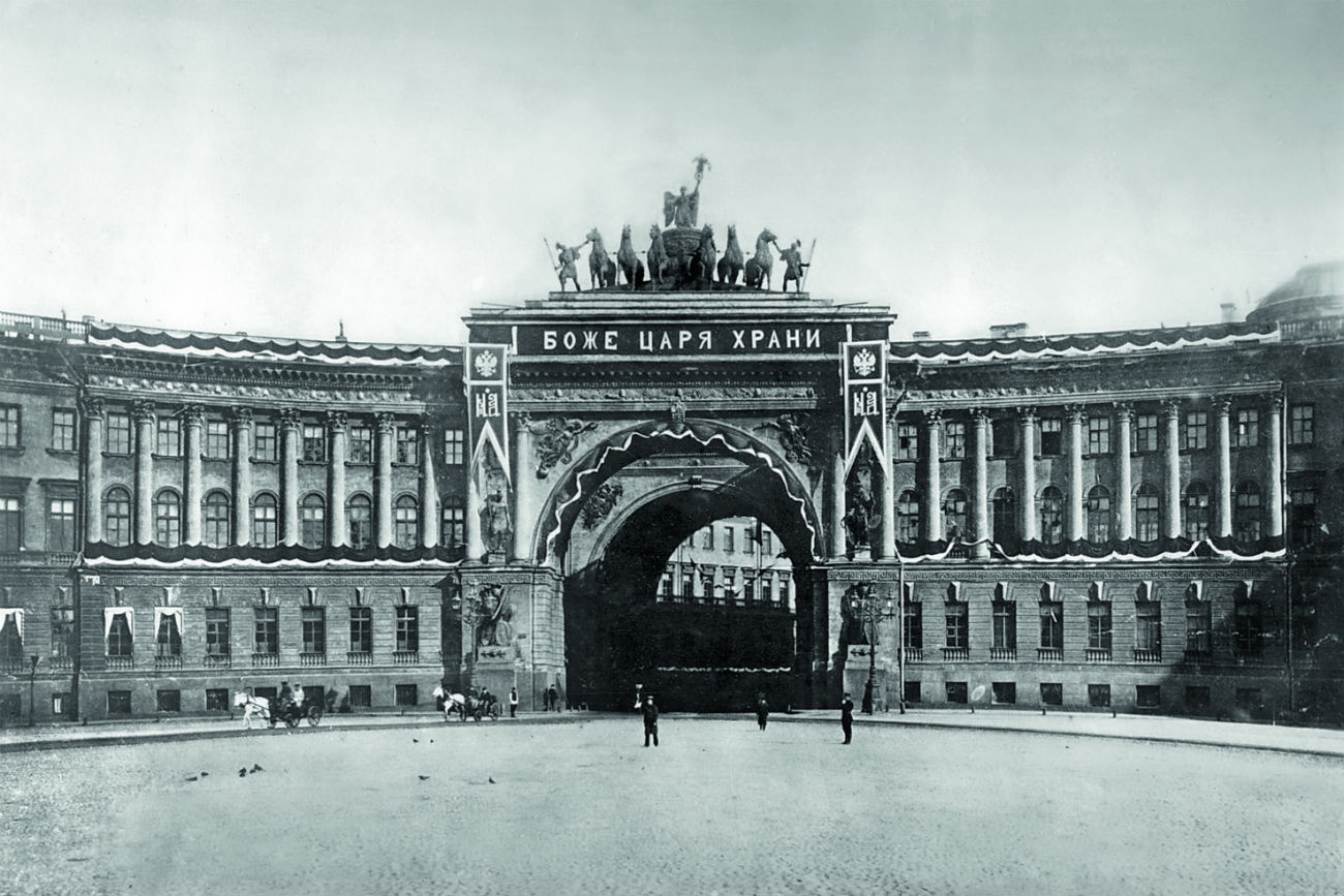 "Almost all the palaces and mansions that were damaged during the Civil War were restored using photographs taken by Bulla before the Revolution. // ""God, Save the Tsar"" caption at the General Staff Building in St. Petersburg"