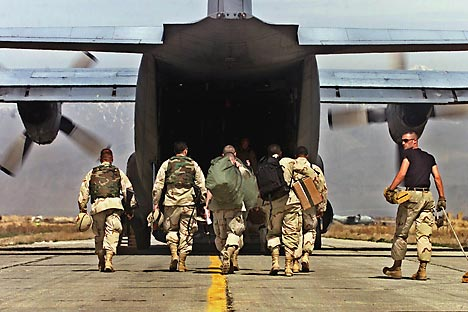 U.S. Army soldiers prepare to board a C-130 aircraft at the army base flightline in Bagram, Afghanistan, for redeployment to Kandahar, Afghanistan. Source: AP
