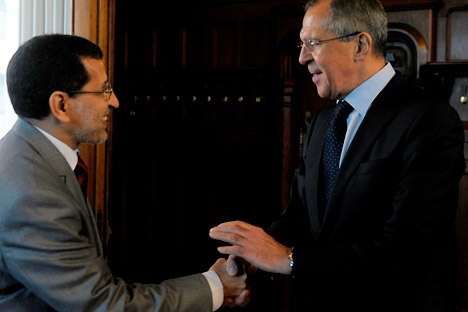 Russian Foreign Minister Sergey Lavrov, right, shakes hands with Morocco's counterpart Saadeddin al-Othmani in Moscow on Wednesday, April 18, 2012. Lavrov warned that only the U.N. Security Council has the authority to evaluate the fulfillment of Kof