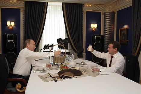 President Medvedev, right, and President-elect Putin enjoy a glass of milk at the former's official residence. Source: ITAR-TASS