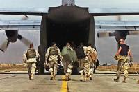 NATO owes the UN an explanation. Pictured: U.S. Army soldiers prepare to board a C-130 aircraft at the army base flightline in Bagram, Afghanistan, for redeployment to Kandahar, Afghanistan. Source: AP