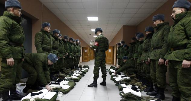"Although the military reform has been ""almost"" completed, a lot needs to be done. Pictured: Company CQ (Charge of Quarters) checking the recruit's outfit. Source: RIA Novosti / Ruslan Krivobok"