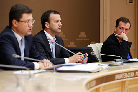 Russia's energy minister Alexander Novak, deputy prime minister Arkady Dvorkovich, and prime minister Dmitry Medvedev (L-R) at a video conference meeting of government officials. The meeting discussed issues related to the national central heating in