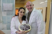 Yulia and Brad Garine show off one of their popular cheesecakes. Source: Press Photo