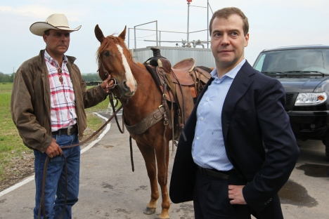 Imports of U.S. livestock - and cowboys - expanded during the presidency of Dmitry Medvedev (right). Source: Photoshot / Vostock-Photo