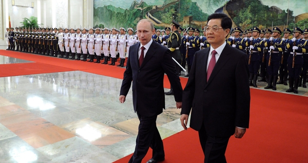 Vladimir Putin and Chinese President Hu Jintao finish reviewing an honor guard at the Shanghai Cooperation Organization summit in Beijing on Tuesday. Source: Reuters / Mark Ralston