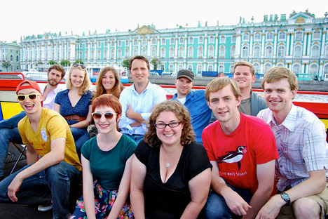 "Russian history professor, Anton Fedyashin with his students on the boat tour in St. Petersburg, during ""Dostoyevsky's Russia"" trip in July. Source: Anita Kondoyanidi."