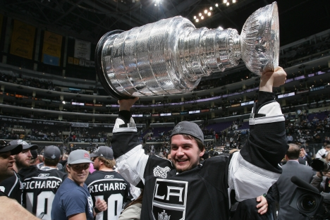 Andrei Loktionov #48 of the Los Angeles Kings lifts the Stanley Cup after the Los Angeles Kings defeated the New Jersey Devils 6-1 in Game Six of the 2012 Stanley Cup Final at the Staples Center on June 11, 2012 in Los Angeles, California. Source: Ge