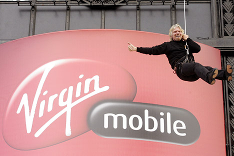 Virgin head Richard Branson descends the facade of the Virgin Megastore building on Paris' Champs Elysees. Source: Reuters / Vostock-Photo.