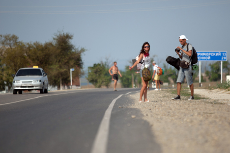 Hitchhiking is still widely accepted as a means of transportation in Russia. Source: PhotoEXpress.