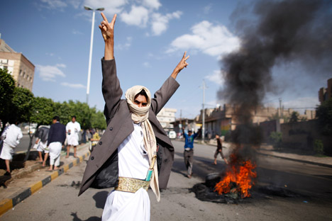The wave of anti-Americanism in the Middle East is hardly likely to change the mind of American politicians, according to Russia's experts. Pictured: A participant of a recent anti-American protest in Yemen. Source: Reuters / Vostock Photo