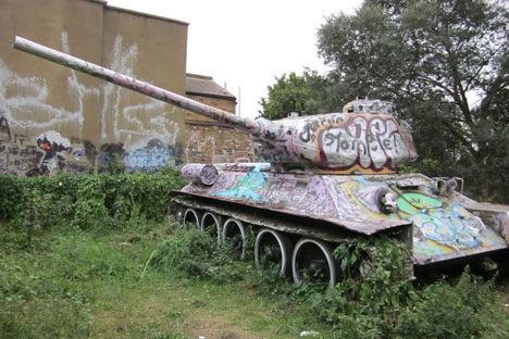 Just around the corner from the gallery, a genuine Russian T34 tank sits on a patch of overgrown wasteland. Source: Press Photo.